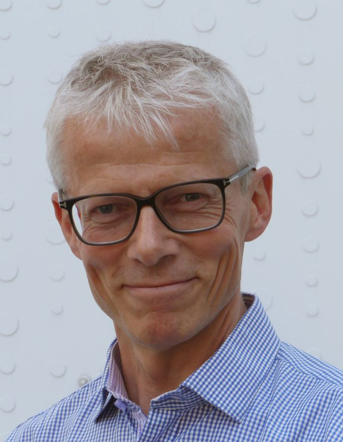 Profilbilde av arbeids- og velferdsdirektør Hans Christian Holte
